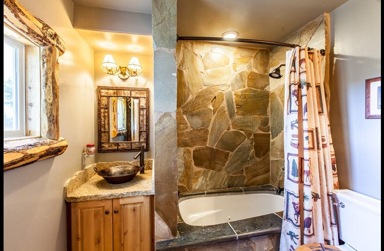 Guest bathroom with custom stone bathtub and shower