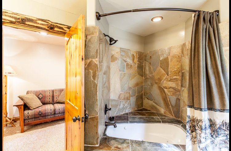 Custom stone bathtub and shower