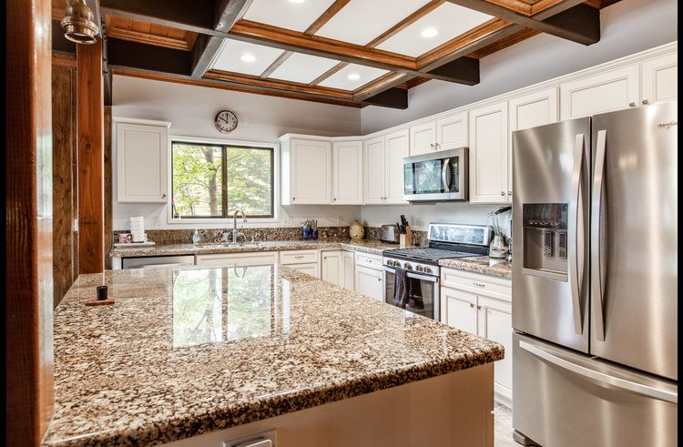 Newly remodeled kitchen with granite counter tops and stainless steel appliances