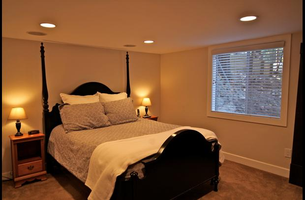Master bedroom with queen bed on lower level