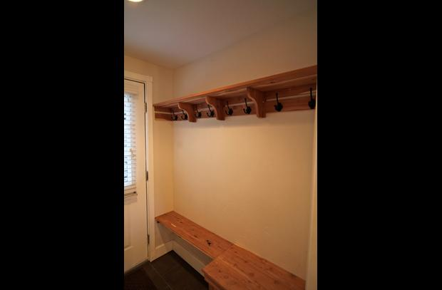 Mud room with aromatic cedar bench and coat rack
