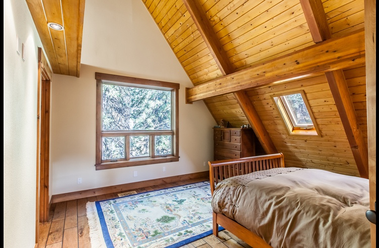 Master suite on upper level with queen bed and attached bathroom