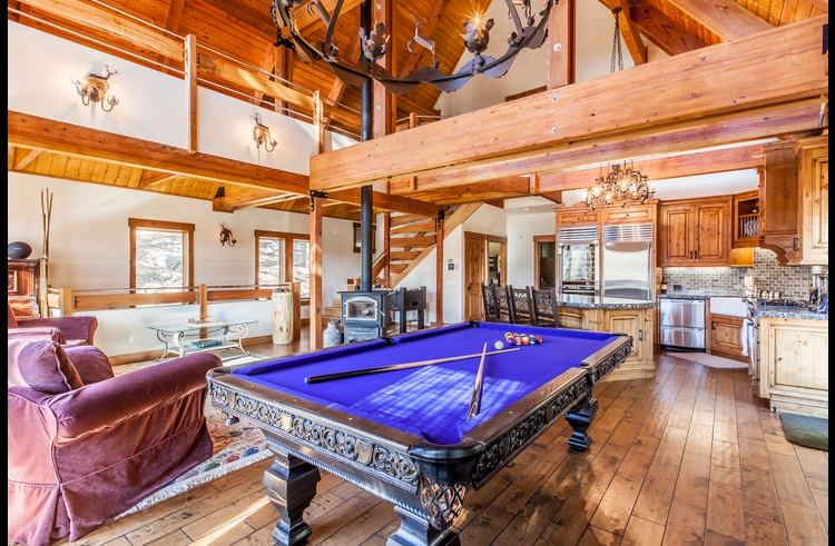 Pool table, kitchen and wood burning stove on the main level