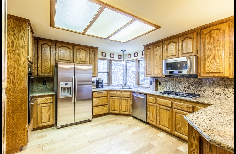 Gourmet kitchen with granite counters and stainless steel appliances