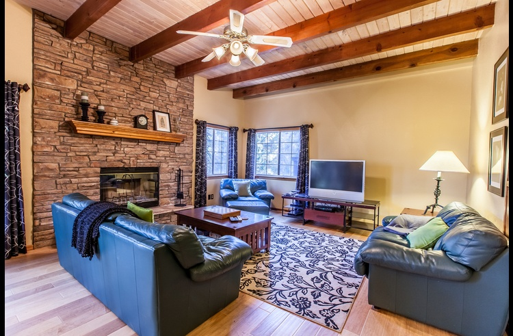 Family room on lower level with wood buring fireplace and TV