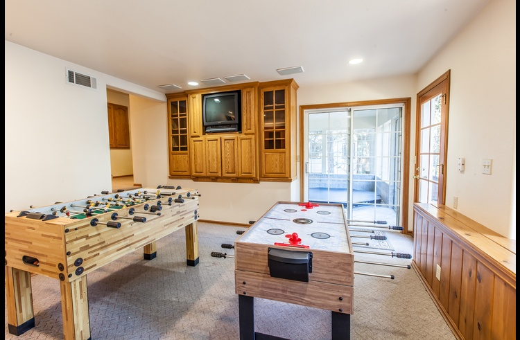 Game room on bottom level with foosball and combination game table