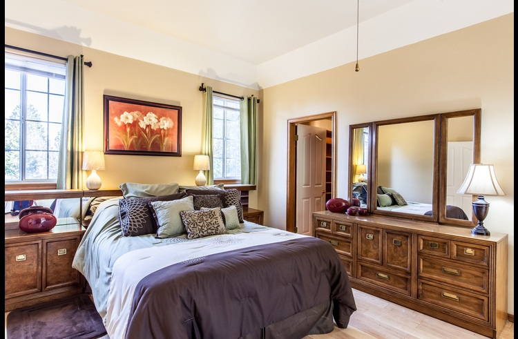 Master suite on the upper level with queen bed