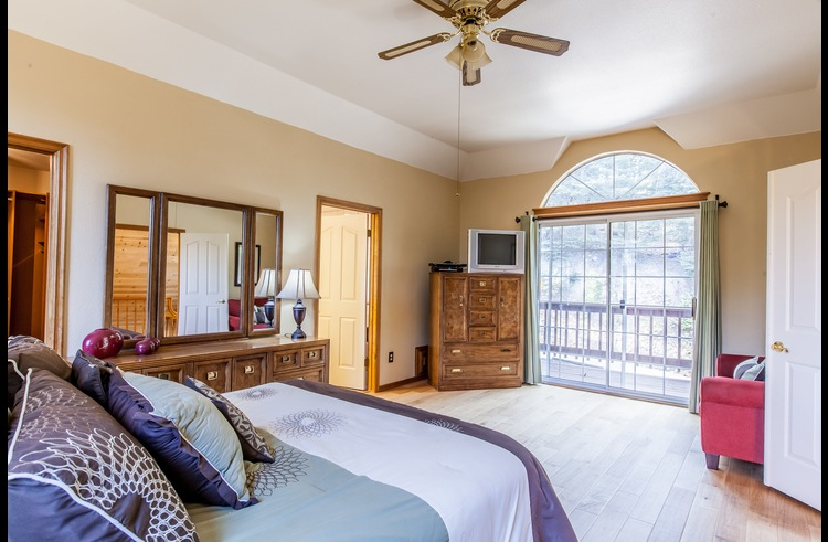 Master suite on the upper level with a queen bed