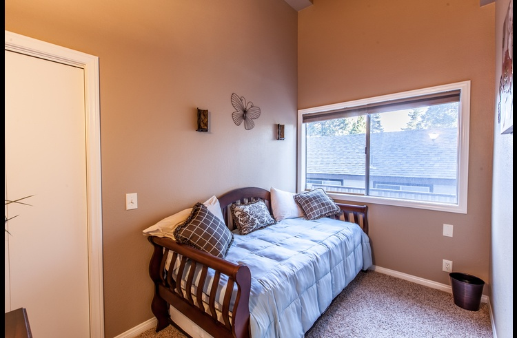 Guest room on upper level with twin bed and trundle