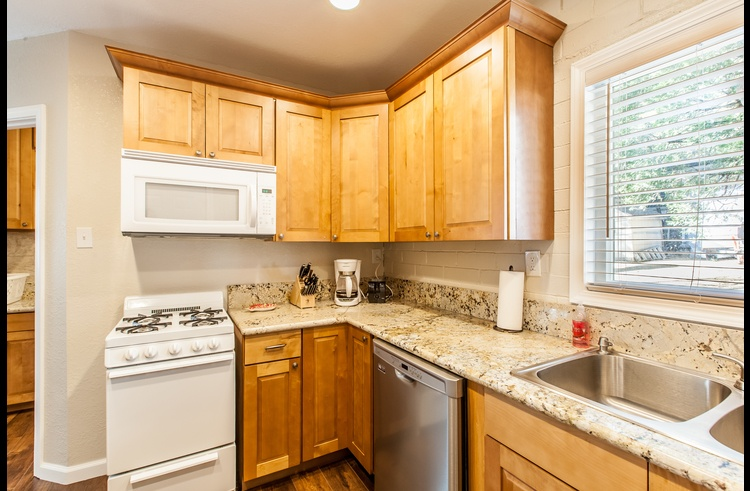 Remodeled kitchen with granite counters