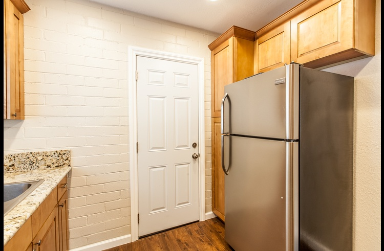 Granite counter tops and stainless steel refrigerator