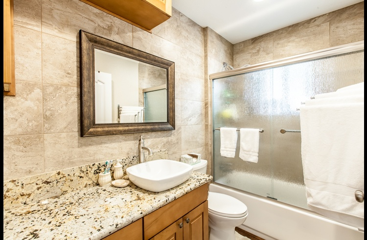 Full bath on the lower level with granite counter tops