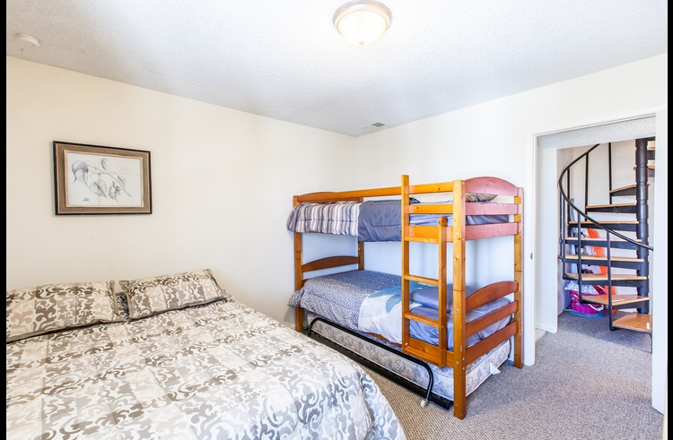 Guest room 2 with queen bed and bunk bed
