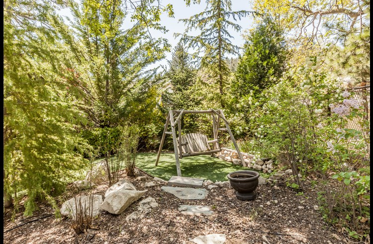 Rustic wood swing to enjoy the outdoors