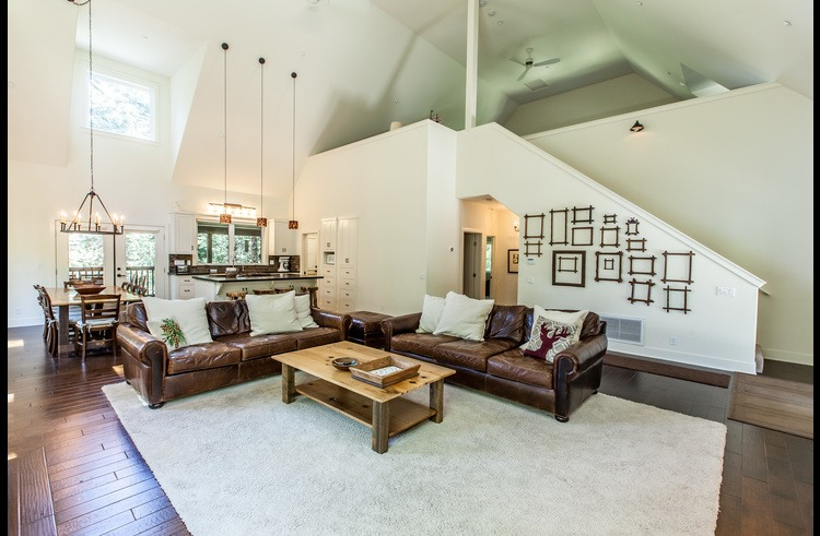 Living room with vaulted ceilings and designer furniture