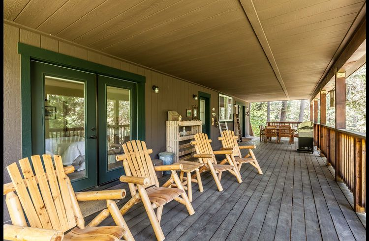 Huge covered deck on the main level with views of the forest!