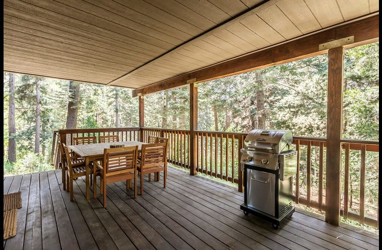 Covered deck with BBQ, dining table and Adirondack chairs!