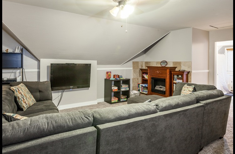 Family room on the upper level with flat screen and pull-out sofa bed
