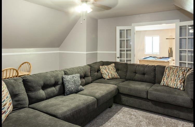 Large sectional sofa in the family room with pull-out bed