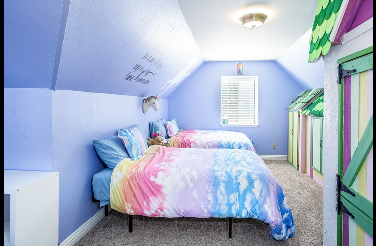 Kids room on upper level with two full size beds and one twin bed