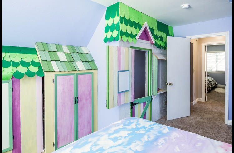 Kids room on upper level with custom designer touches for kids to play