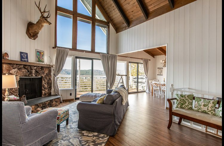 Living room with beautiful view of the lake and vaulted ceilings