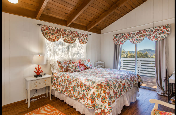 Bedroom on upper level with view of lake