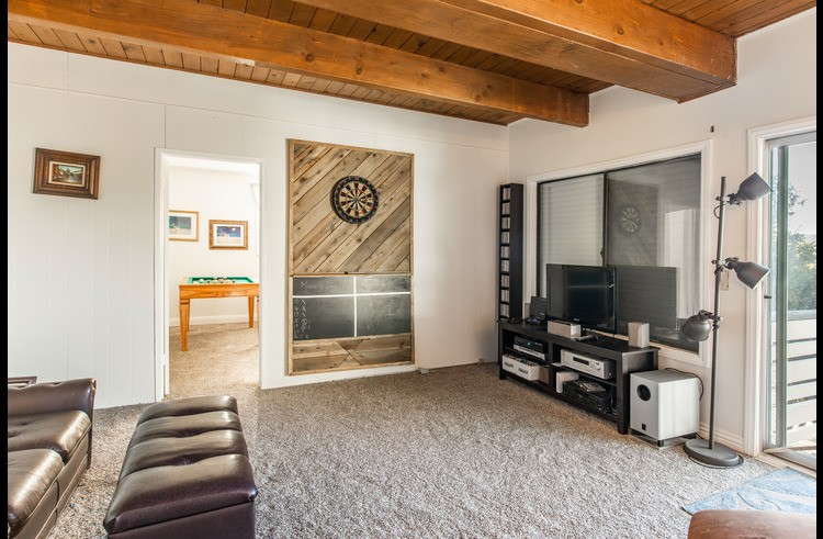 Lower level with dart board and sleeper sofa