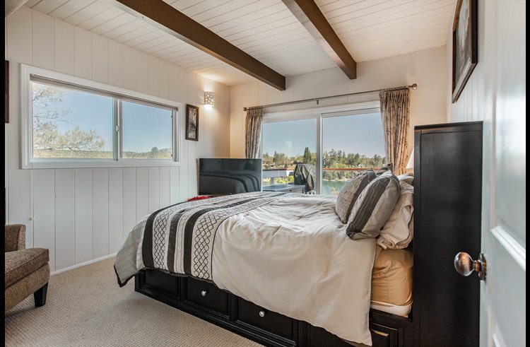 Guest room on main level with king bed and amazing lake views