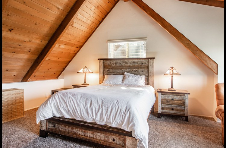 Master bedroom with vaulted ceiling and Queen size bed