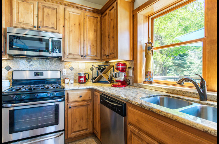 Remodeled kitchen with granite counters and stainless steel appliances