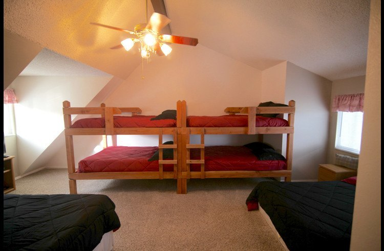Bunk room on upper level with 1 queen and 5 full size beds