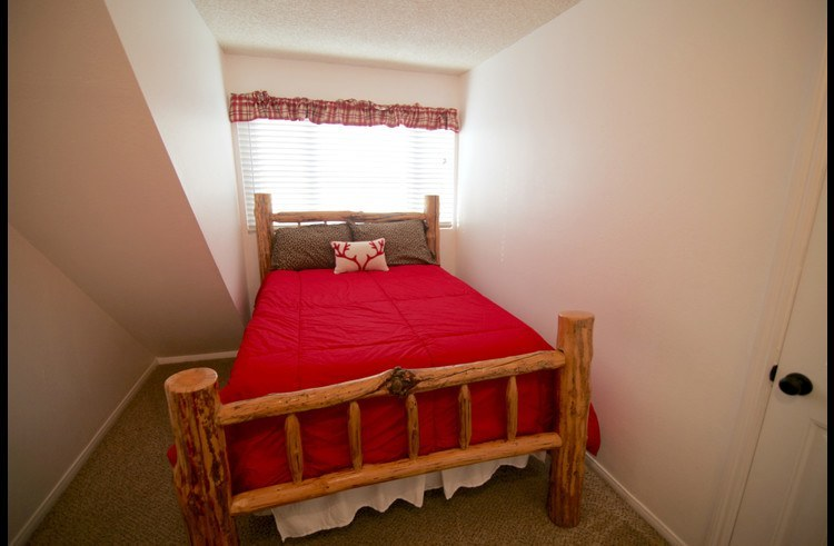 Guest room on upper level with full size bed