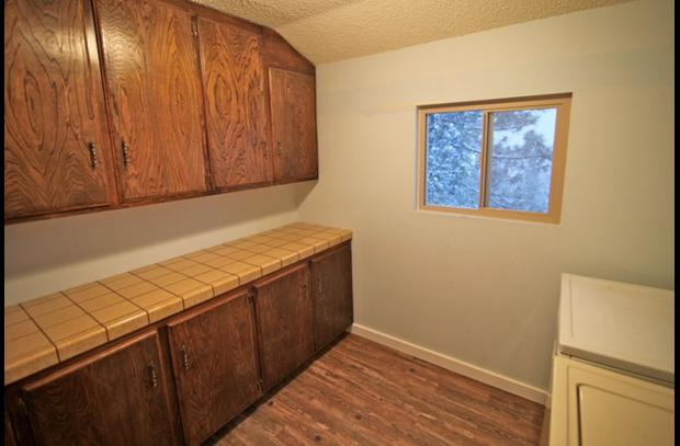 Ample counter space and cabinets in laundry room