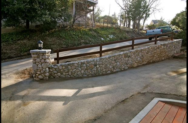 River rock retaining wall at driveway