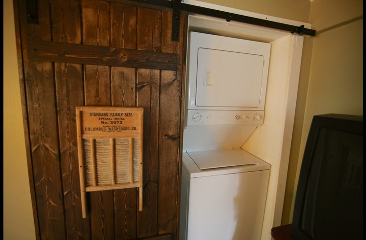 Stackable washer/dryer behind sliding barn yard door