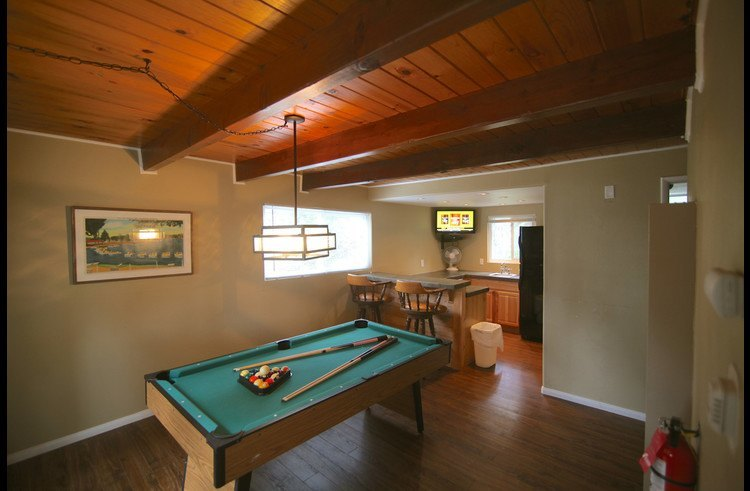 Game room on lower level with pool table and wet bar with flat screen TV