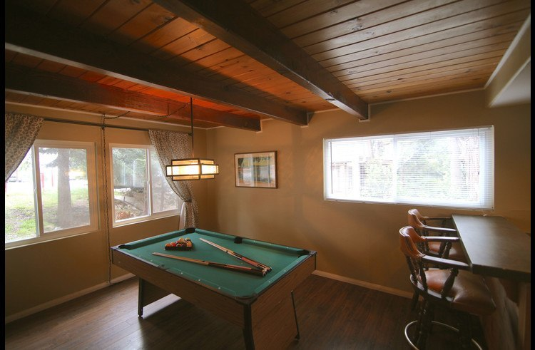 Pool table in game room on lower level