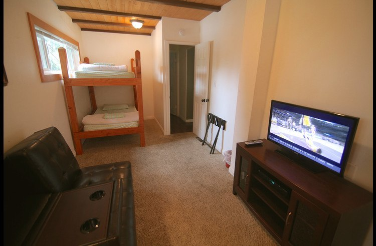 Bunk Room with convertible futon couch with flat screen TV