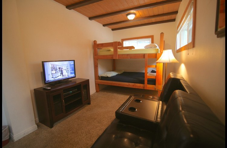 Great room for kids to enjoy bunk beds and couch with flat screen TV