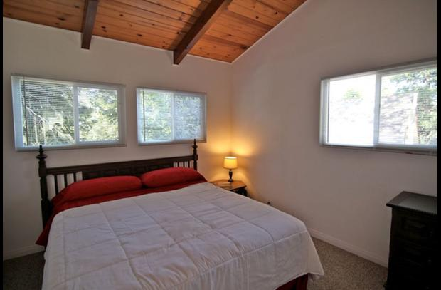 Master bedroom with california king bed