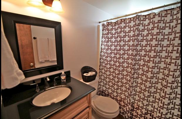 Bathroom on lower level with black granite counter top