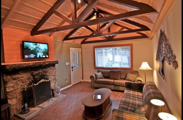 Flat screen TV above the wood burning stone fireplace