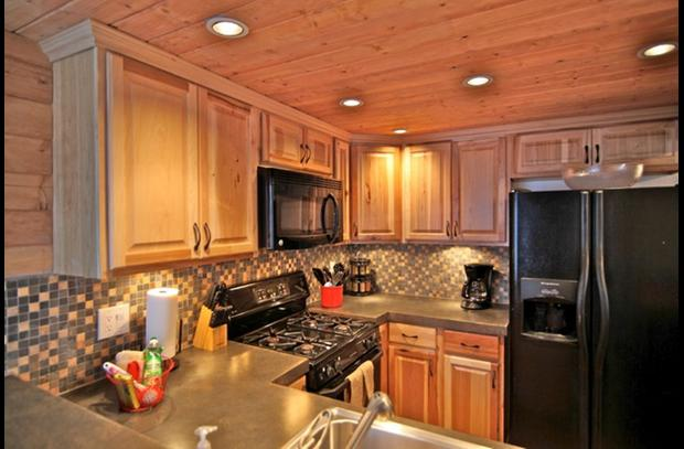 Brand new hickory kitchen cabinets and knotty pine ceiling