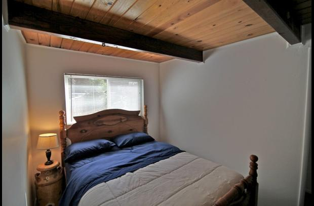 Guest room on lower level with queen bed