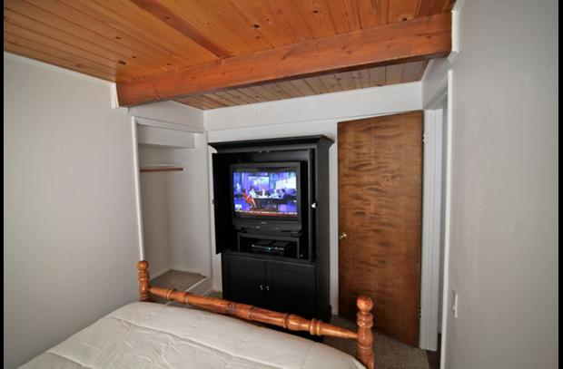 TV in armoir in bedroom on lower level