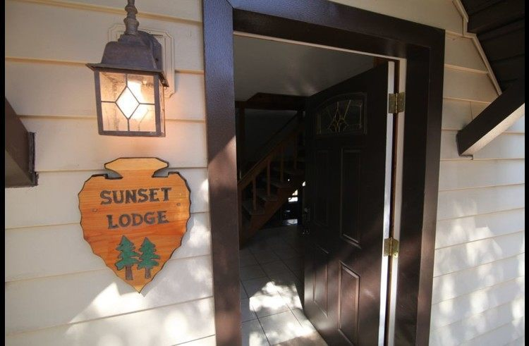 Front door with Sunset Lodge Arrowhead