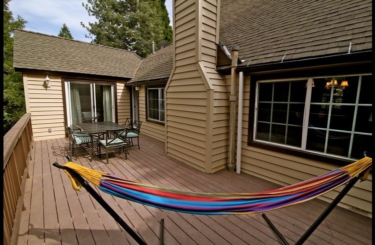 Large deck with hammock and dining table