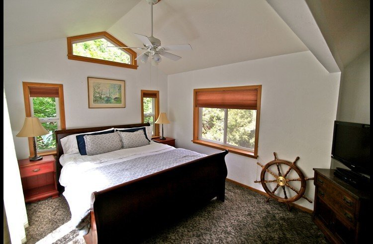 Master bedroom with vaulted ceilings and king size bed