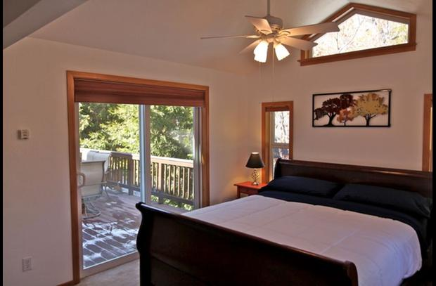 Master bedroom with sliding door the large deck
